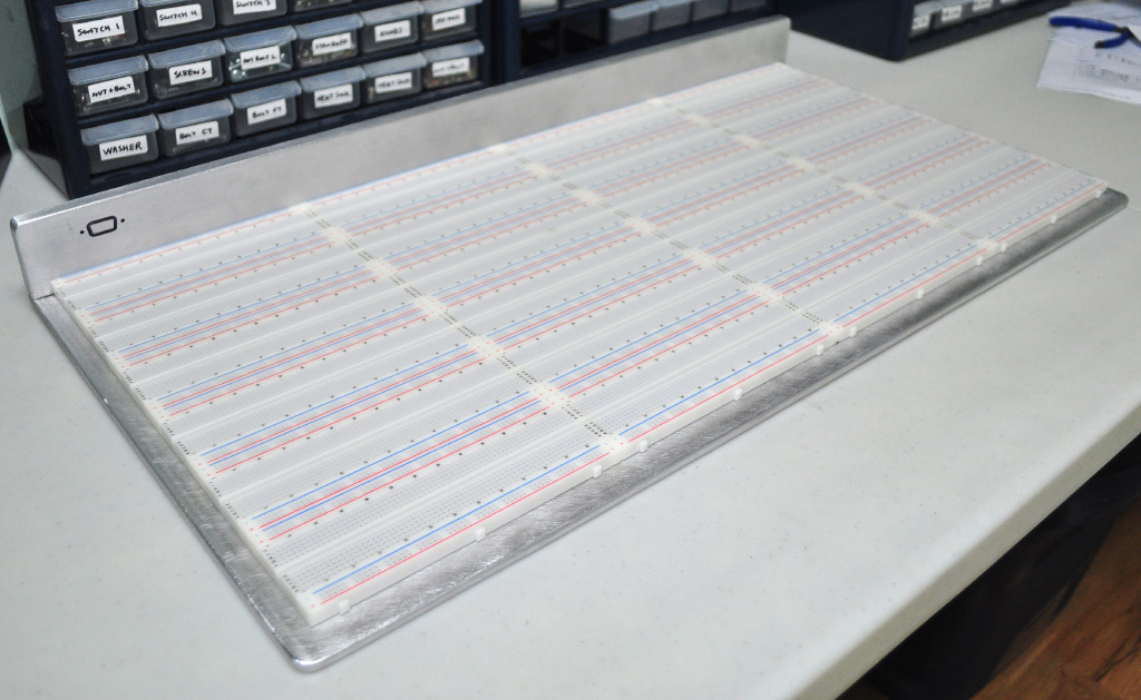 24 breadboards fastened to base